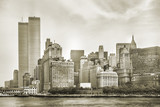 Fototapeta Nowy Jork - New York City skyline from NJ with World Trade Center featured as landmark of Twin Towers, destroyed in September 11, 2001. Sepia background, vintage style. Lower Manhattan in NYC, United States.
