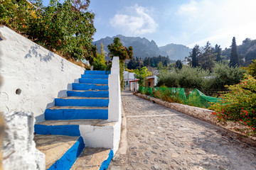 Fototapeta Street in the center of the mountain village Zia on the island of Kos, a beautiful landscape, a popular destination for traveling in Europe
