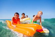 Teenage Boys Having Fun Surfin...