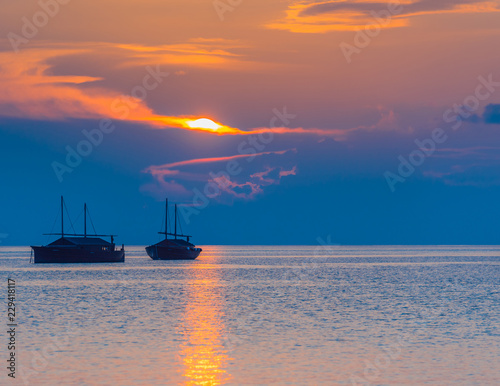 In de dag Schip Dhoni boats on sunset background, Maldives. Copy space for text.