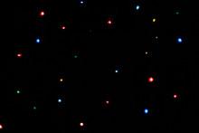 Multicolored Lights Blurred Bokeh On Dark Background