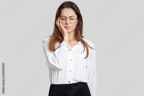 Photo Of Tired Overworked Female Office Worker Keeps Eyes