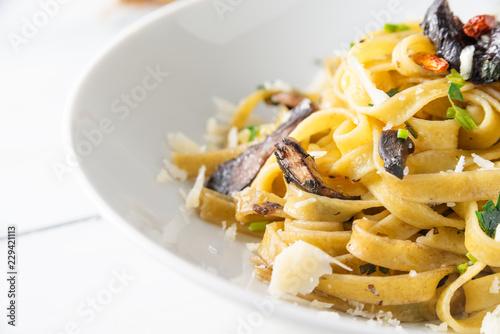 Fotografia  Tagliatelle ai funghi e parmigiano