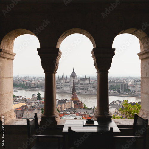 Fotobehang Meer / Vijver View of the Parliament in Budapest, through archways of Fisherman's Bastion, Hungary