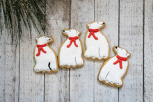Decorated White Polar Bear Wearing A Red Scarf Christmas Sugar Cookies, Isolated On A Whitewashed Wood Background, With Holiday Garland