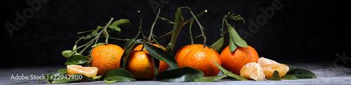 fresh ripe tangarines, food closeup on grey background
