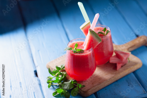 Fotografie, Obraz  Tasty cold watermelon smoothie drink with mint in glasses, summer refreshing coc