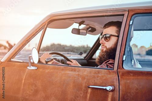 Bearded male in sunglasses ...