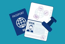 Passport With Biometric Data And Visa Stamps On It Isolated On Blue