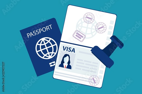 Fototapeta Passport with biometric data and visa stamps on it isolated on blue
