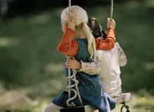 Two Little Girls On Swing