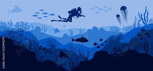Valokuvatapetti Coral reef and Underwater wildlife Diver on blue sea background