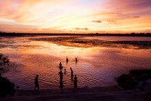 Shot In Sri Lanka.  This Group Of Boys In The Lake Reminded Me Of A Simpler Way Of Life.  The Dramatic Sky Provided The Perfect Backdrop For Their Silhouetted Figures.