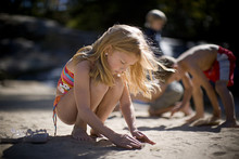 Girl Building Sand Castle On T...