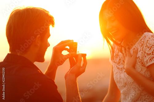 Fototapeta  Successful marriage proposal at sunset
