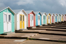 A Row Of Beach Houses In England