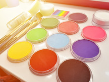 Color Cosmetics, Glitters, Brushes And Sponges For Face Painting On Children Party