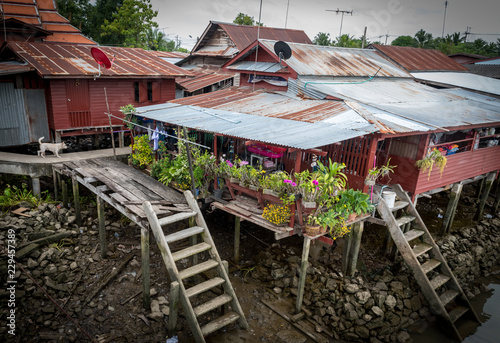Fotografie, Obraz  House with flowers on canal in Thailand