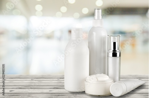 Cosmetic containers isolated on background Canvas Print