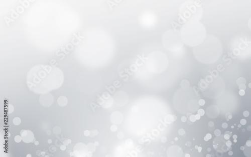 Fototapeta Silver light background with blur bokeh. beautiful christmas backdrop. festive defocused. cosmetic advertising design obraz na płótnie