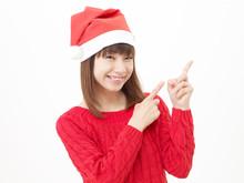 女性 クリスマス 指差し