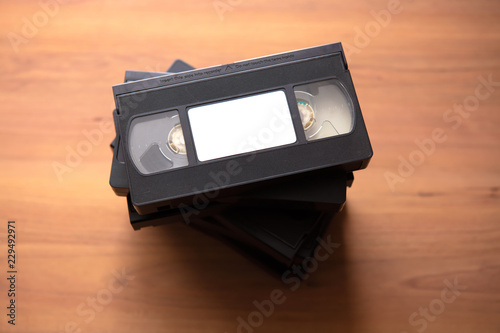 Fotografering Stacked VHS vcr video cassette tape with white blank label.