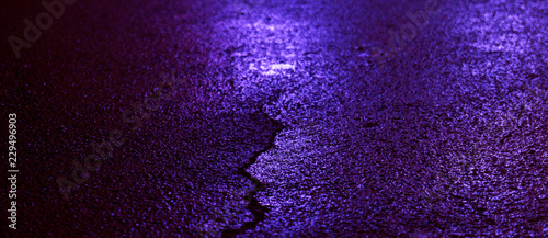 Background of wet asphalt with neon light. Blurred background, night lights of a big city, reflection, puddles. Dark neon bokeh. - 229496903