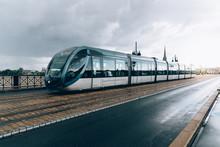 Modern City Tram Crossing Brid...