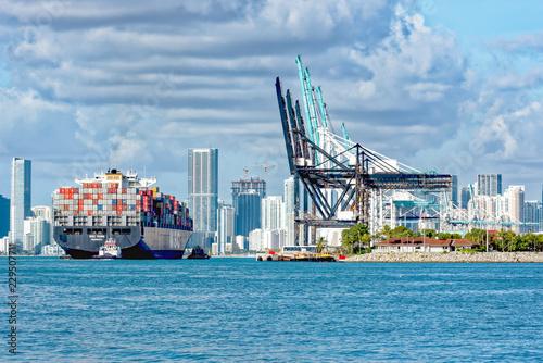 Fotografie, Obraz  Tug guiding container ship into Port Miami