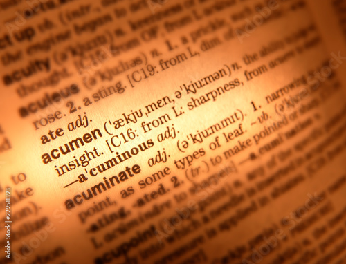 Photo CLOSE UP OF DICTIONARY PAGE SHOWING DEFINITION OF THE WORD ACUMEN