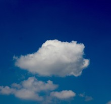 The White Cloud In The Bright Blue Sky.