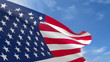 USA fabric flag waving in the blue sky.