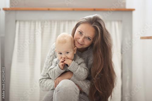 Fotografie, Obraz  Happy mother and baby hugging, closeup portrait