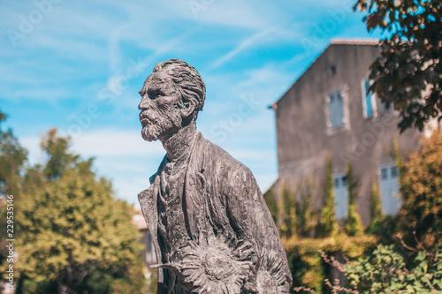 Deurstickers Afrika Saint-Remy-de-Provence, France, September 24, 2018: Statue of Vincent Van Gogh on the background of a psychiatric hospital