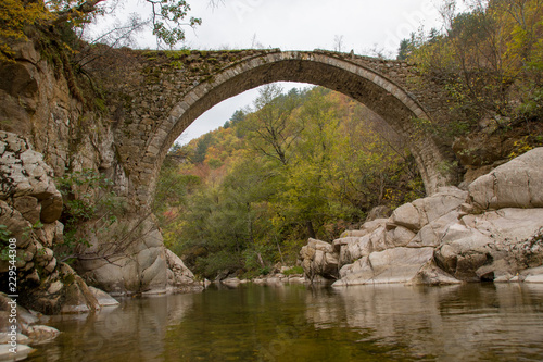 Recess Fitting Bridge Traditional old stone bridge on river in Greece