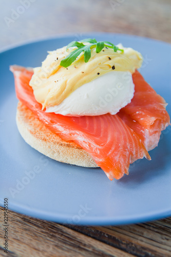 Egg Benedict with Smoked Salmon and Hollandaise Sauce on English Muffin.