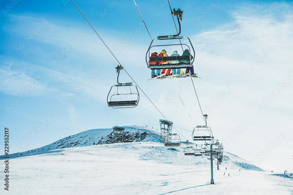 Fototapety, obrazy: People on ski lift in winter ski resort