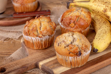 Banana Nut Muffins On A Wooden...