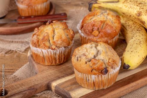 Fotografie, Obraz Banana Nut Muffins on a Wooden Board