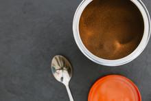 Instant Coffee In Tin Jar Spoon On Dark Background