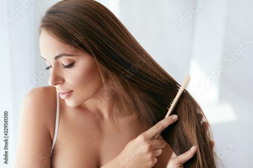 Beauty Hair Care. Beautiful Woman Combing Long Natural Hair Canvas Print
