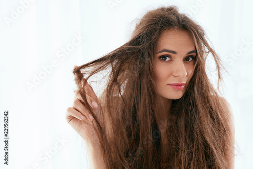 Fotografie, Obraz  Hair Problem. Woman With Dry And Damaged Long Hair