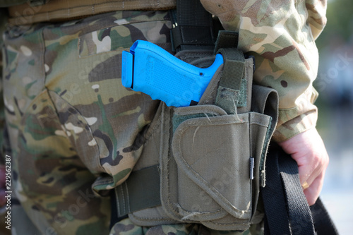 Photo  Pistol of soldier of KORD (police strike force, Ukrainian SWAT) placed in a hols