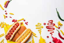 Top View Of Delicious Hot Dogs And Fries With Mustard And Ketchup On White Surface