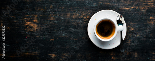 Espresso coffee On a wooden background. Top view. Free copy space.
