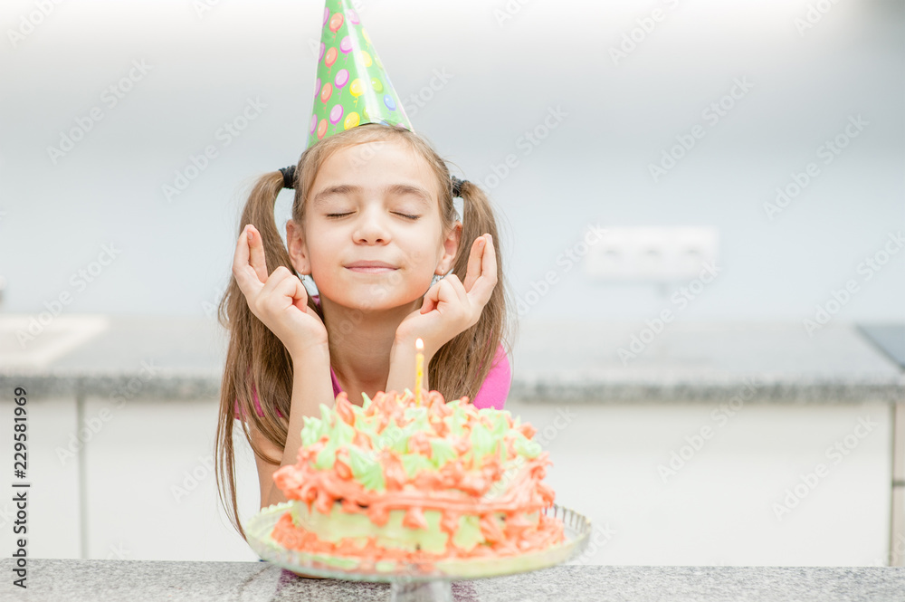 Girl The Birthday Hat With A Cake Candles Makes Wish His Fingers Cro Foto Poster Wandbilder Bei EuroPosters