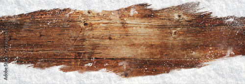 Bożenarodzeniowego sztandaru drewniany tło z śniegiem