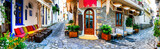 Fototapeta Uliczki - Traditional colorful Greece - charming old streets of Skiathos town