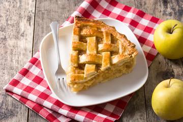 Fototapeta Homemade apple pie slice on wooden table
