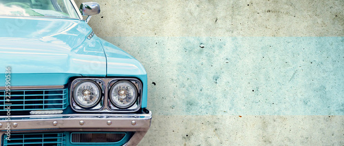 Recess Fitting Vintage cars The headlight of the old beautiful car on the background of a concrete wall. Copy space. Concept banners repair, sale of cars.